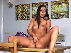 Naughty girl sitting totally naked in