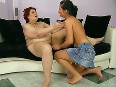 Red haired granny Daisey Lee spread her legs and having her nasty old cunt licked off by young beauty lesbian girlfriend Hetty