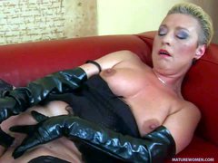 Mature lady Bettany wears black fetish outfit made of leather