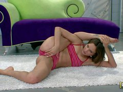 Flexible Amber Rayne dressed in pink does sexy stretching exercises