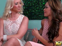 Molly Cavalli and Daisy Marie lift up their dresses and