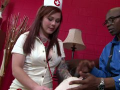 Sexy red-haired nurse Misti Dawn gives pleasure to black man