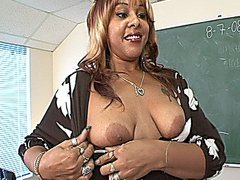 Sexy black teacher gives her student a blowjob and lets him fuck her