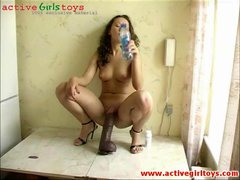 Beauty perched atop a monster dildo to ride