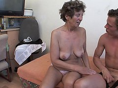 Naughty granny getting fucked by a younger man
