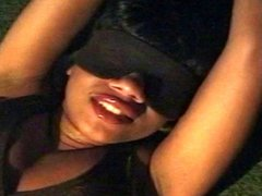 Sexy black babe in bondage and blindfolded