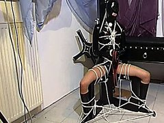 German sub in latex gets put into bondage by her master
