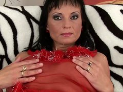 Tessa is a mature babe with juicy natural jugs and