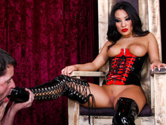 Black haired asian domina Asa Akira in latex corset shows