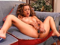 Blue dildo makes her squirt