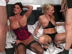 Two lingerie sluts in a bukkake scene