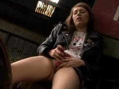 Schoolgirl in leather jacket toys pussy