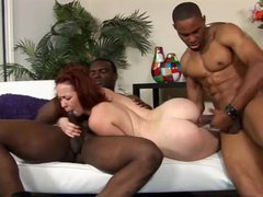 Two black guys fuck a sexy slender redhead