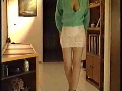 She wears a sexy skirt and a green cardigan