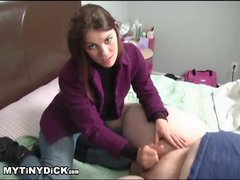 Fully dressed chick giving a small cock handjob