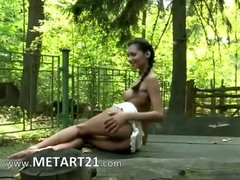 Young brunett babe teasing in the woods