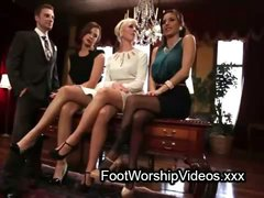 Guy licking feet to three secretaries