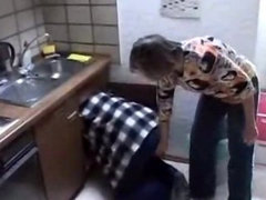 Mother and daughter fucked in the kitchen