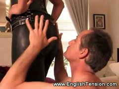 Sexy leather clad domina queens her sub