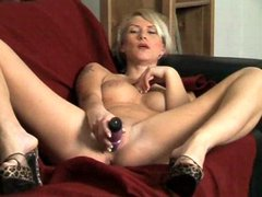 Babe plays with her dildo