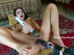 Ambitious woman with big breasts gets her cunt fucked by a vibrator while having her clit teased