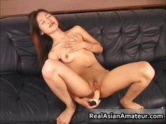 Real asian masturbating with her