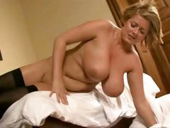 Blonde with huge tits is stripping and putting on a nice show