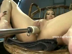 Brunette gives up her clothes and sits down on fucking table spreading large her pussy and legs