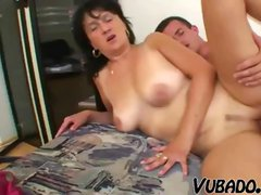 Mature brunette with big saggy tits gets nailed by young dude