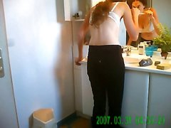 Cute redhead is caught on hidden camera dressing in bathroom