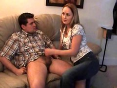 Blonde Shannon is teasing this guy and jerking him off on the couch