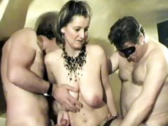 Busty mature brunette gets invited for a hardcore masked men gangbang