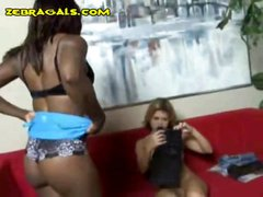 Ebony lesbian mistress keeps her blonde slave in check with toys