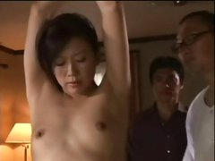 Skinny young Asian is tied up gagged and humiliated by her capture