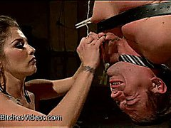 Suspended upside down guy zippered by busty mistress
