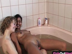 Lesbians in a whirlpool licking twat