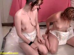 Petite teens in diapers crawling around the house