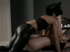Two girls in latex erotica with strap on