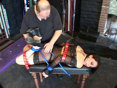 Sexy brunette in see-thru, trussed up like a turkey for a BDSM session
