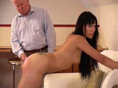 Girl is spanked and then caned hard
