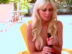 Bikini blonde with big hooters erotically plays outdoors