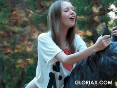 Skinny teen doll Gloria taking her clothes off outdoor